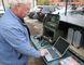 Don Gilroy talks on a Frontenac Amateur Radio Group radio in Glenburnie on Friday. Elliot Ferguson/The Whig-Standard)