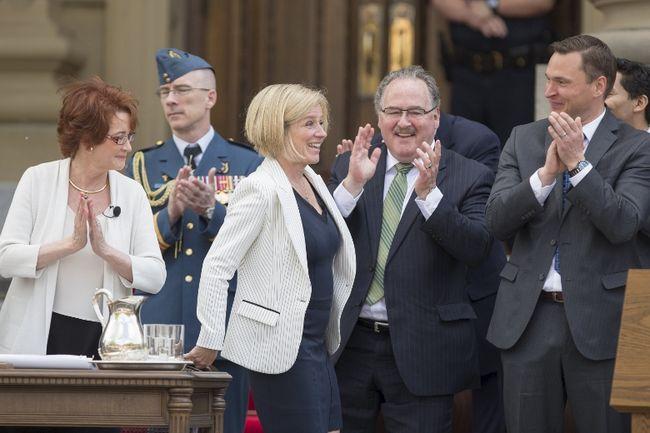 Alberta New Democratic Party (NDP) Leader Rachel Notley (C) is sworn in as Alberta's 17th premier at her official swearing-in ceremony in Edmonton, Alberta, May 24, 2015. REUTERS/Topher Seguin