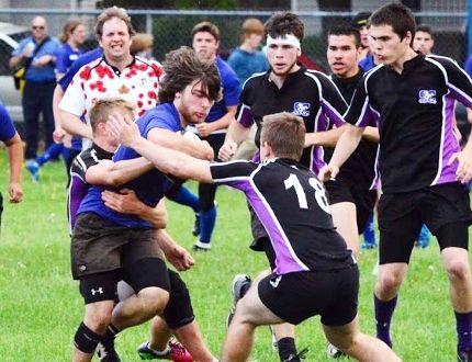 Sarnia Collegiate Blue Bombers inside centre Alex Gratton fights through a tackle during a Lambton Kent senior boys high scho