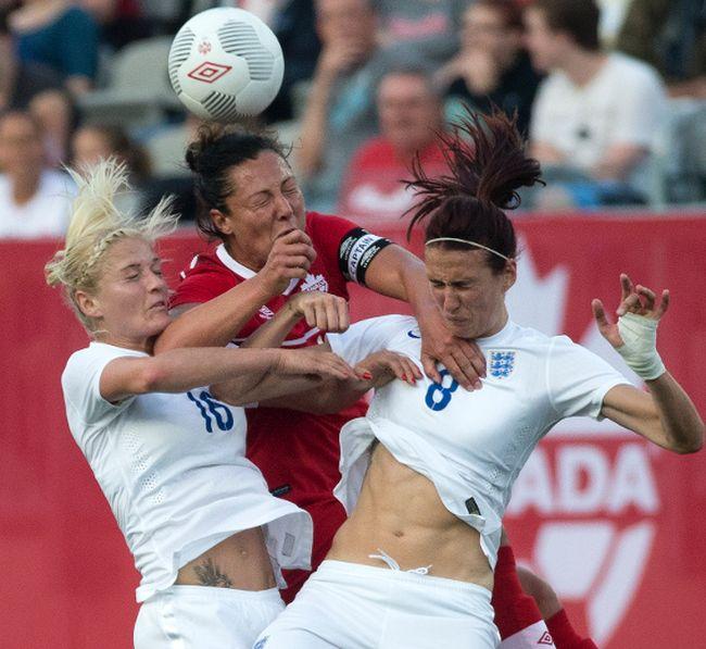 Canada's Melissa Tancredi (centre) battles in the air against England's Jill Scott (right) and Katie Chapman in Hamilton last night. Canada kicks off its World Cup next Saturday vs. China. (Craig Robertson/Toronto Sun)