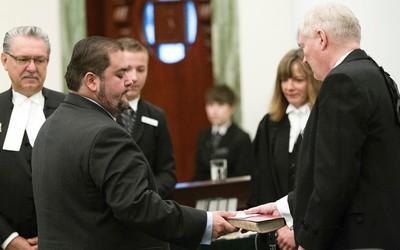 Edmonton-Ellerslie MLA Rod Loyola (left) and members of the NDP caucus are sworn-in at the Alberta Legislature, in Edmonton Alta. on Monday June 1, 2015. David Bloom/Edmonton Sun/Postmedia Network