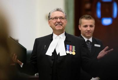 Speaker of the Alberta Legislative Assembly Gene Zwozdesky receives a standing ovation after members of the PC caucus are sworn-in at the Alberta Legislature, in Edmonton Alta. on Monday June 1, 2015. David Bloom/Edmonton Sun/Postmedia Network