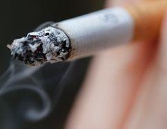A woman smokes a cigarette. REUTERS/Christian Hartmann