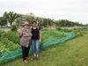 Iris Kozarchuk, left, and Coun. Jenny Gerbasi at the Grant Avenue community gardens in 2014.