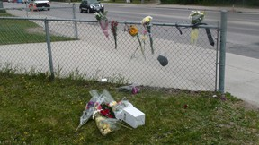 A vigil for Brett Bourne outside Kelvin High School June 3, 2015. Bourne was fatally stabbed at the scene June 2.