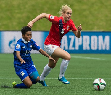 Norwegian Elise Thorsnes battles with Thailands Anootsara Maijarern in action at the FIFA Women's World Cup Canada 2015 at Lansdowne Stadium in Ottawa on Sunday June 7, 2015. Errol McGihon/Ottawa Sun/Postmedia Network