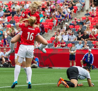 Norwegian Ada Hegerberg celebrates a goal with teammate Elise Thorsnes against Thailand in action at the FIFA Women's World Cup Canada 2015 at Lansdowne Stadium in Ottawa on Sunday June 7, 2015. Errol McGihon/Ottawa Sun/Postmedia Network