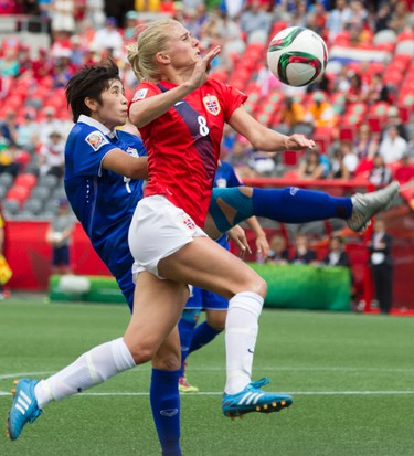 Norwegian Solveig Gulbrandsen battles with Thailands Duangnapa Sritalaj in action at the FIFA Women's World Cup Canada 2015 at Lansdowne Stadium in Ottawa on Sunday June 7, 2015. Errol McGihon/Ottawa Sun/Postmedia Network