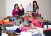 Yola Ventresca, left, and Marisa Kanas ready the dozens of handbags destined for auction at the third annual Handbags for Hospice fundraiser. (DEREK RUTTAN, The London Free Press)