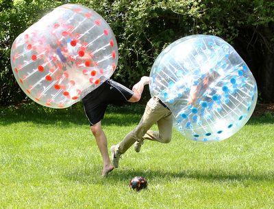 Josh Dielmann (l) and Josh Tataryn fight for the ball during a bubble soccer game in Winnipeg, Man. Wednesday June 10, 2015.  Brian Donogh/Winnipeg Sun/Postmedia Network