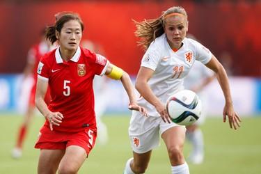 Netherlands' Lieke Martens (11) and China's Wu Haiyan (5) chase a ball during a FIFA Women's World Cup 2015 match at Commonwealth Stadium in Edmonton, Alta., on Thursday June 11, 2015. Ian Kucerak/Edmonton Sun/Postmedia Network