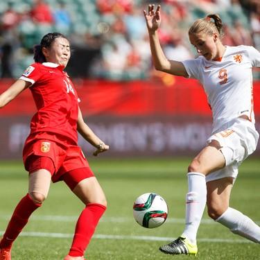 Netherlands' Vivianne Miedema (9) and China's Zhao Rong (14) battle during a FIFA Women's World Cup 2015 match at Commonwealth Stadium in Edmonton, Alta., on Thursday June 11, 2015. Ian Kucerak/Edmonton Sun/Postmedia Network