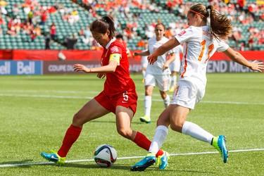 Netherlands' Lieke Martens (11) and China's Wu Haiyan (5) battle during a FIFA Women's World Cup 2015 match at Commonwealth Stadium in Edmonton, Alta., on Thursday June 11, 2015. Ian Kucerak/Edmonton Sun/Postmedia Network