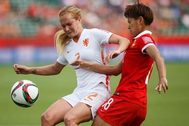 Netherlands' Desiree van Lunteren (2) intercepts China's Han Peng (18) during a FIFA Women's World Cup 2015 match at Commonwealth Stadium in Edmonton, Alta., on Thursday June 11, 2015. Ian Kucerak/Edmonton Sun/Postmedia Network