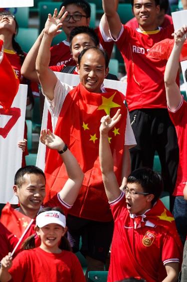 Chinese fans cheer China during a FIFA Women's World Cup 2015 match against the Netherlands at Commonwealth Stadium in Edmonton, Alta., on Thursday June 11, 2015. Ian Kucerak/Edmonton Sun/Postmedia Network