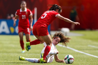 Netherlands' Dani�lle van de Donk (10) is taken down by China's Wu Haiyan (5) during a FIFA Women's World Cup 2015 match at Commonwealth Stadium in Edmonton, Alta., on Thursday June 11, 2015. Ian Kucerak/Edmonton Sun/Postmedia Network