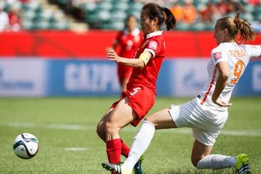 Netherlands' Vivianne Miedema (9) checks China's Wu Haiyan (5) during a FIFA Women's World Cup 2015 match at Commonwealth Stadium in Edmonton, Alta., on Thursday June 11, 2015. Ian Kucerak/Edmonton Sun/Postmedia Network