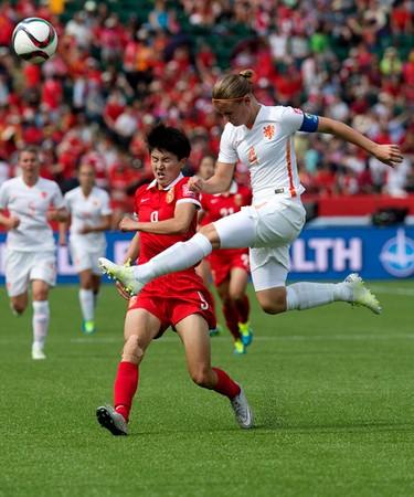 Team China's Wang Shanshan (9) battles the Netherlands' Mandy van den Berg (4) during FIFA Women's World Cup Canada 2015 action at Commonwealth Stadium, in Edmonton Alta. on Thursday June 11, 2015. David Bloom/Edmonton Sun/Postmedia Network