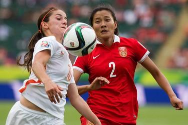 Team China's Liu Shanshan (2) battles the Netherlands' Dani�lle van de Donk (10) during FIFA Women's World Cup Canada 2015 action at Commonwealth Stadium, in Edmonton Alta. on Thursday June 11, 2015. China won 1-0. David Bloom/Edmonton Sun/Postmedia Network