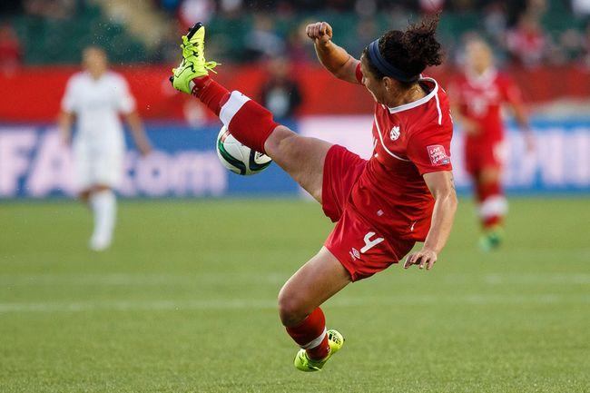 Canada's Carmelina Moscato kicks a ball in the air during a FIFA Women's World Cup match against New Zealand at Commonwealth Stadium on June 11, 2015. (Ian Kucerak/Edmonton Sun/Postmedia Network)