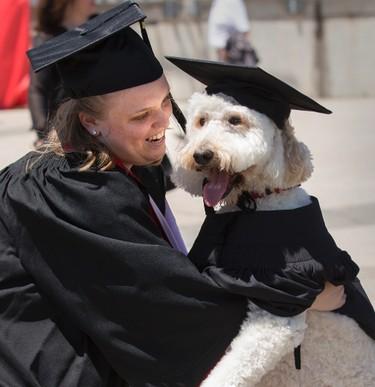 York University student, Devon MacPherson graduates with her mental health service dog  Barkley on Tuesday June 16, 2015. Craig Robertson/Toronto Sun/Postmedia Network