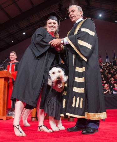 York University student, Devon MacPherson graduates with her mental health service dog, Barkley on Tuesday June 16, 2015. Craig Robertson/Toronto Sun/Postmedia Network