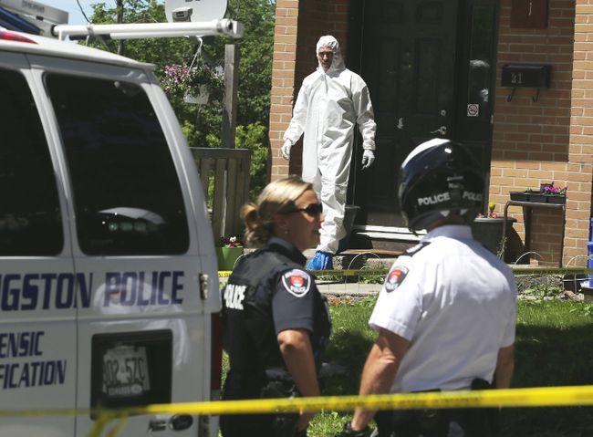 A police forensics officer walks out of unit 21 at 312 Conacher Drive in Kingston, Ont., the scene of Thursday's killing of Kaitlan Babcock, on Friday, June 19, 2015 Elliot Ferguson/Kingston Whig-Standard/Postmedia Network
