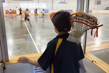 A boy watch the lacrosse playoffs at Coronation Arena in Edmonton, Alberta on Saturday, June 20, 2015. Perry Mah/Edmonton Sun/Postmedia Network