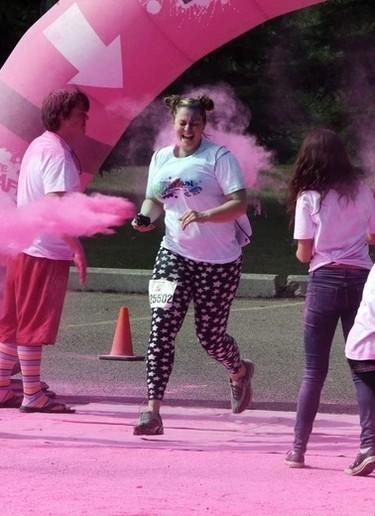 A runner gets hit in the Pink Zone during the Graffiti Run art Rundle Park in Edmonton, Alberta on Sunday, June 21, 2015. Perry Mah/Edmonton Sun/Postmedia Network