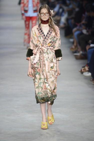 A model rocks a floral robe for Gucci at Milan Men's Fashion Week Spring/Summer 2016.
