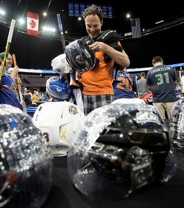 Ryan Scott looks over equipment for sale during the Edmonton Oilers Locker Room Sale at Rexall Place, in Edmonton Alta. on Saturday June 27, 2015. David Bloom/Edmonton Sun/Postmedia Network
