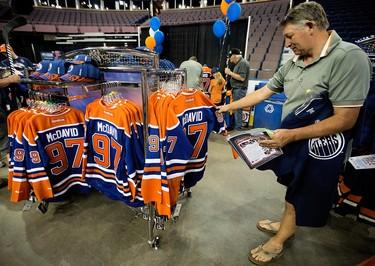 Joey Boisvert checks out Connor McDavid jerseys during the Edmonton Oilers Locker Room Sale at Rexall Place, in Edmonton Alta. on Saturday June 27, 2015. David Bloom/Edmonton Sun/Postmedia Network