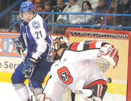 Sudbury Wolves Andrey Kuchin scores on Ottawa 67's goalie Petr Mrazek during OHL hockey action in Sudbury in 2011. Kuchin proved to be one of the Wolves' most impactful import draft picks. Gino Donato/The Sudbury Star/Postmedia Network