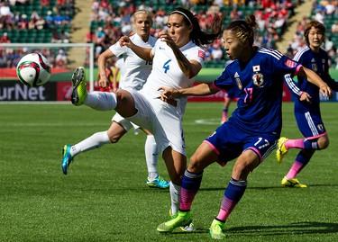 Japan's Yūki Ōgimi (17) battles England's Fara Williams (4) during first half FIFA Women's World Cup Canada 2015 action at Commonwealth Stadium, in Edmonton Alta. on Wednesday July 1, 2015. David Bloom/Edmonton Sun/Postmedia Network