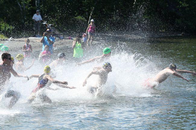 Swimmers hit the water for the Ian McCloy Island Swim at the university beach on Lake Nepahwin on Sunday. Ben Leeson/The Sudbury Star/Postmedia Network