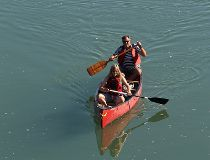People paddle down the North Saskatchewan River.