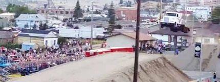 Gregg Godfrey sets a new world record after jumping a semi-truck 166 feet.