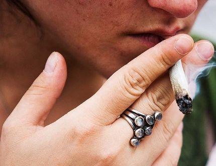 Person smoking marijuana - pot - joint