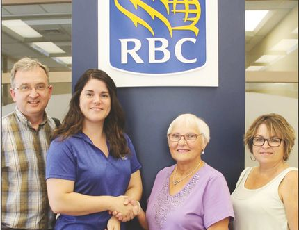 Carman-Dufferin Habitat for Humanity's Harold Kenyom, Muriel Derksen and Brenda O'Brien gratefully accepted a $10,000 donation from RBC's Miranda Rowson on July 10. (EMILY DISTEFANO/CARMAN VALLEY LEADER)