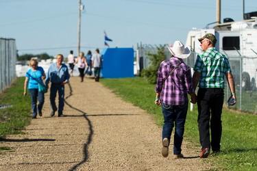Campers walk towards the stage during Big Valley Jamboree 2015 in Camrose, Alta. on Thursday July 30, 2015. Ian Kucerak/Edmonton Sun/Postmedia Network