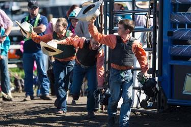 The Harman Welding team is introduced for the wild pony race during Bulls For Breakfast at Big Valley Jamboree 2015 in Camrose, Alta. on Friday July 31, 2015. Ian Kucerak/Edmonton Sun/Postmedia Network