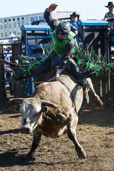 Lonnie West from Cadogan, Alta., rides during Bulls For Breakfast at Big Valley Jamboree 2015 in Camrose, Alta. on Friday July 31, 2015. Ian Kucerak/Edmonton Sun/Postmedia Network
