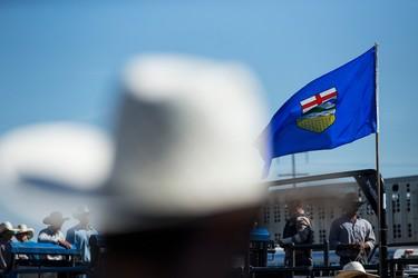 The Alberta flag is seen during Bulls For Breakfast at Big Valley Jamboree 2015 in Camrose, Alta. on Friday July 31, 2015. Ian Kucerak/Edmonton Sun/Postmedia Network
