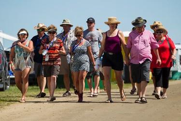 Campers walk through the site during Big Valley Jamboree 2015 in Camrose, Alta. on Friday July 31, 2015. Ian Kucerak/Edmonton Sun/Postmedia Network