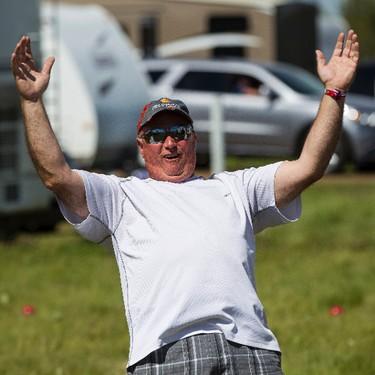 Art Martin from Whitecourt, Alta., plays bean bag during Big Valley Jamboree 2015 in Camrose, Alta. on Friday July 31, 2015. Ian Kucerak/Edmonton Sun/Postmedia Network