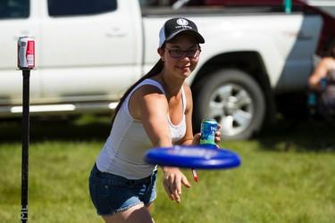 Hayley Faria plays beersby with friends during Big Valley Jamboree 2015 in Camrose, Alta. on Friday July 31, 2015. Ian Kucerak/Edmonton Sun/Postmedia Network