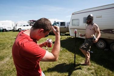 McCrae Iler (right) celebrates friend Tyler Lund's beersby shot during Big Valley Jamboree 2015 in Camrose, Alta. on Friday July 31, 2015. Both are from Calgary. Ian Kucerak/Edmonton Sun/Postmedia Network