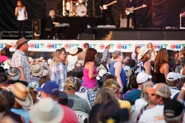 Fans file to their seats as Reba McEntire walks on the main stage during Big Valley Jamboree 2015 in Camrose, Alta. on Friday July 31, 2015. Ian Kucerak/Edmonton Sun/Postmedia Network