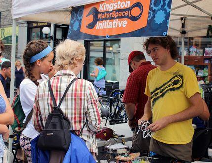 Ryan d'Eon of Kingston Makerspace speaks to passerbys at the Princess Street Promenade in Kingston, Ont. on Saturday August 1, 2015. Steph Crosier/Kingston Whig-Standard/Postmedia Network