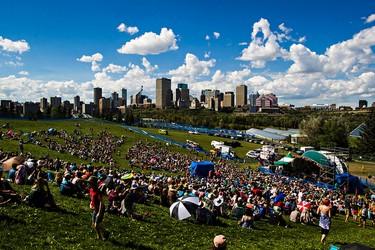 Edmonton's skyline is seen from Stage 6 during the Edmonton Folk Music Festival at Gallagher Park in Edmonton, Alta. on Saturday, Aug. 8, 2015. Codie McLachlan/Edmonton Sun/Postmedia Network